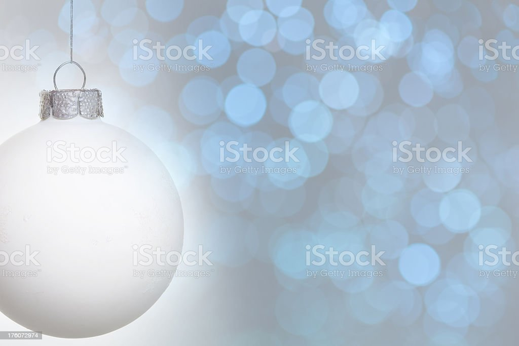 Christmas Bauble on blue defocused background royalty-free stock photo