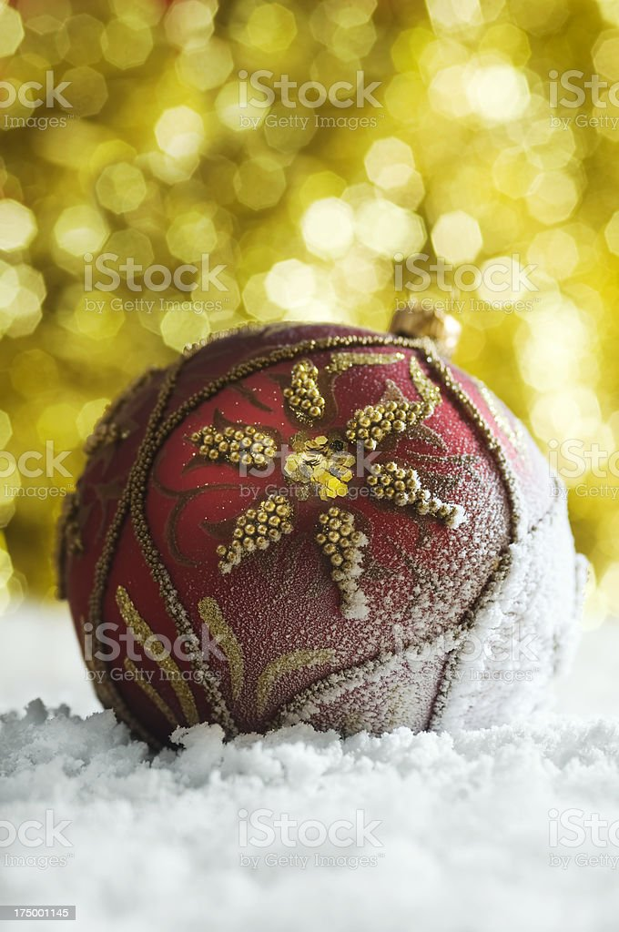 Christmas bauble on defocused lights background royalty-free stock photo