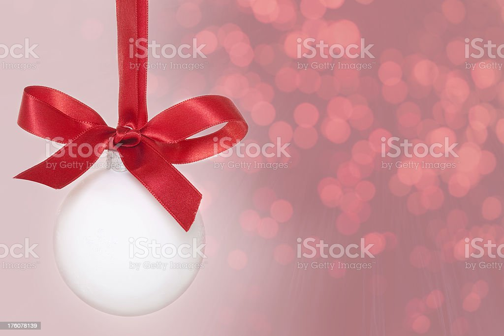 Christmas Bauble on red defocused background royalty-free stock photo