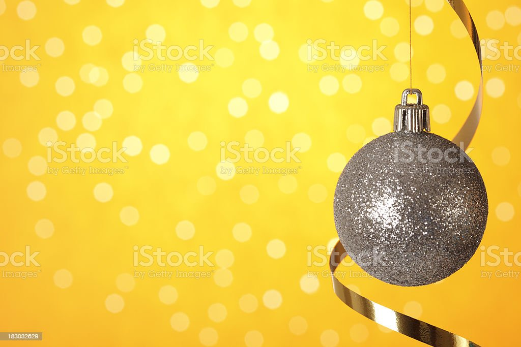 Christmas bauble on yellow background royalty-free stock photo