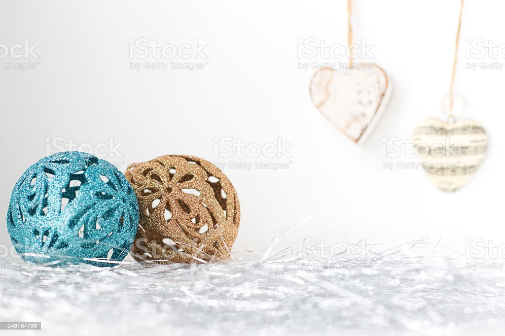 Christmas baubles and hearts on white background stock photo