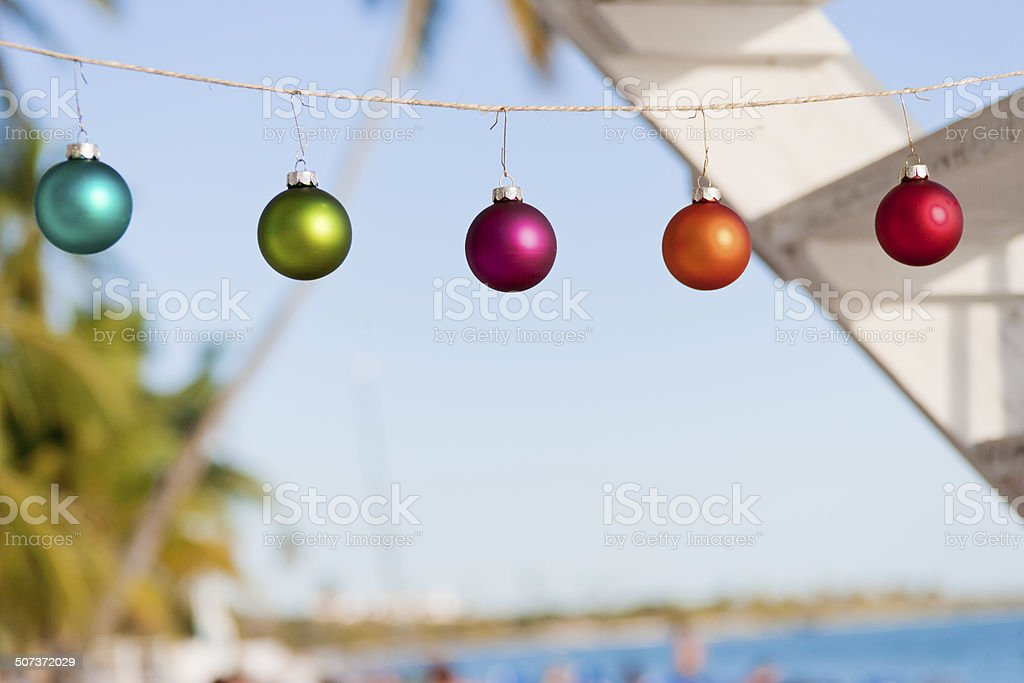 Christmas baubles at tropical beach royalty-free stock photo