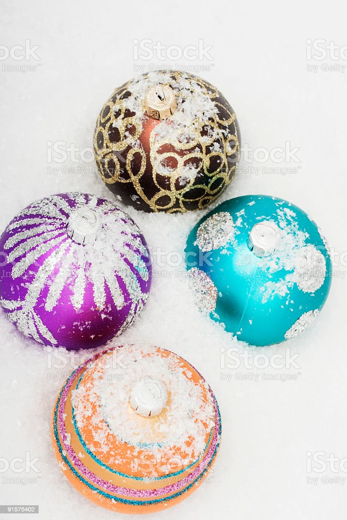 Christmas baubles in snow royalty-free stock photo