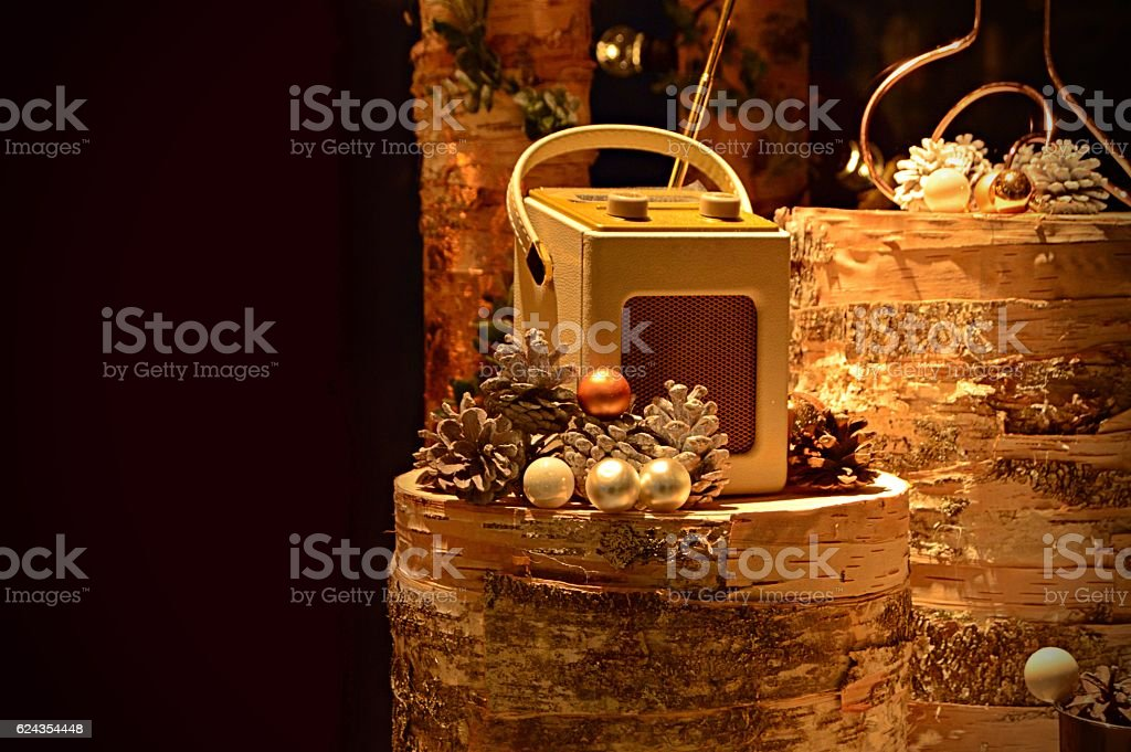 Christmas baubles, pine cones with old Radio on wooden log stock photo
