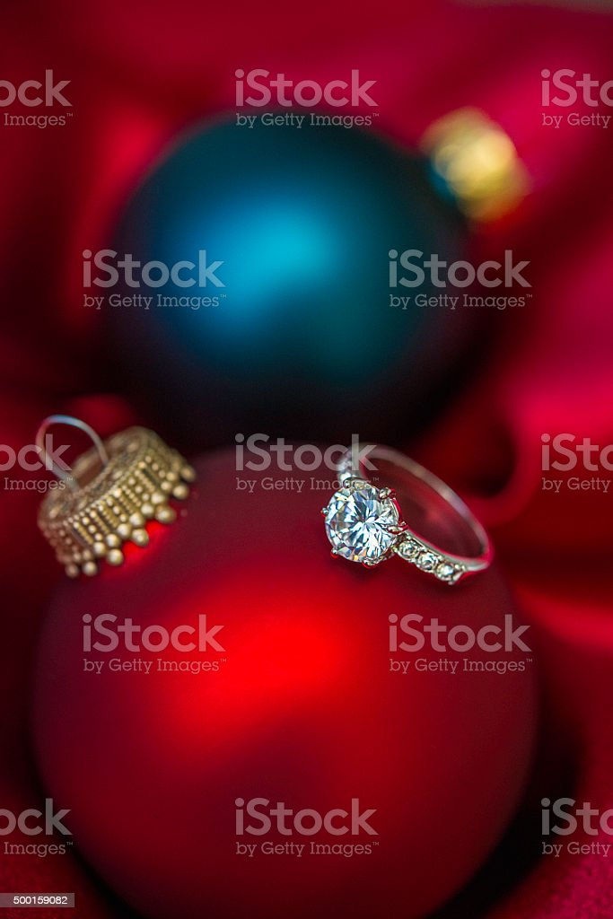 Engagement Ring In Christmas Ornament Part - 23: Christmas Baubles With Engagement Ring In Red Satin Royalty-free Stock Photo