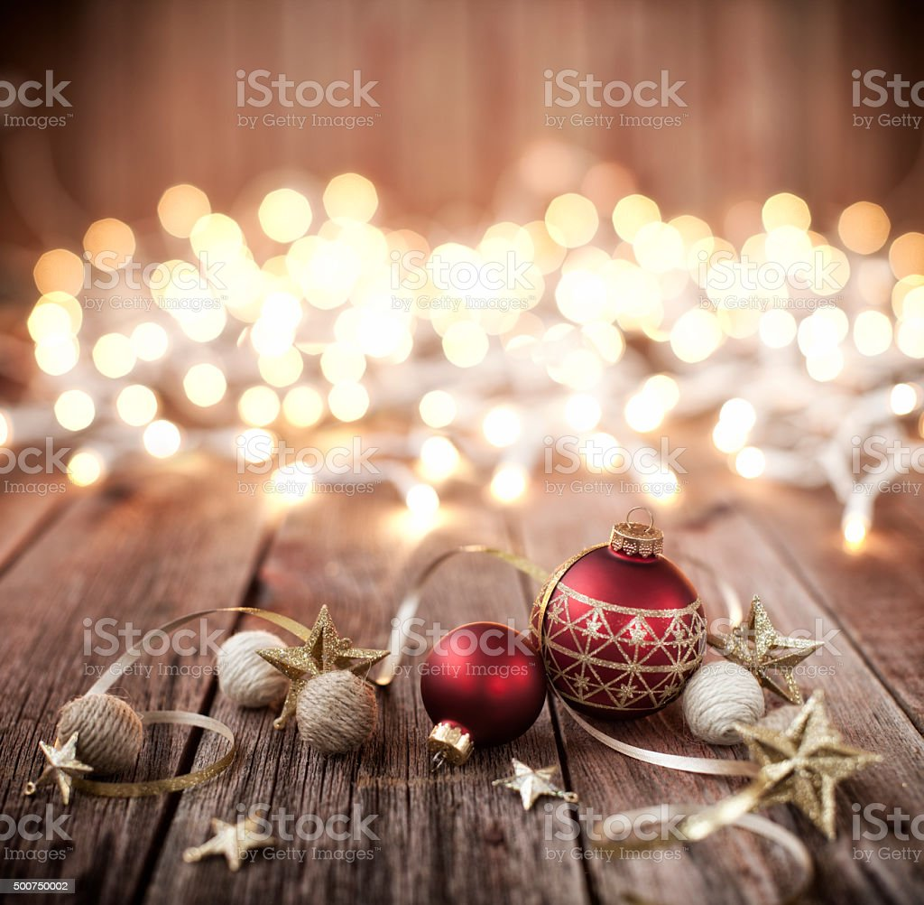 Christmas Baubles with Ribbon and Stars on Old Wood Background stock photo