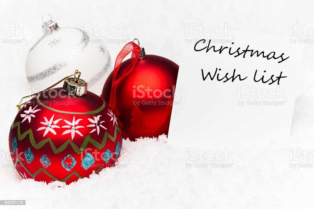 Christmas baubles with wish list stock photo