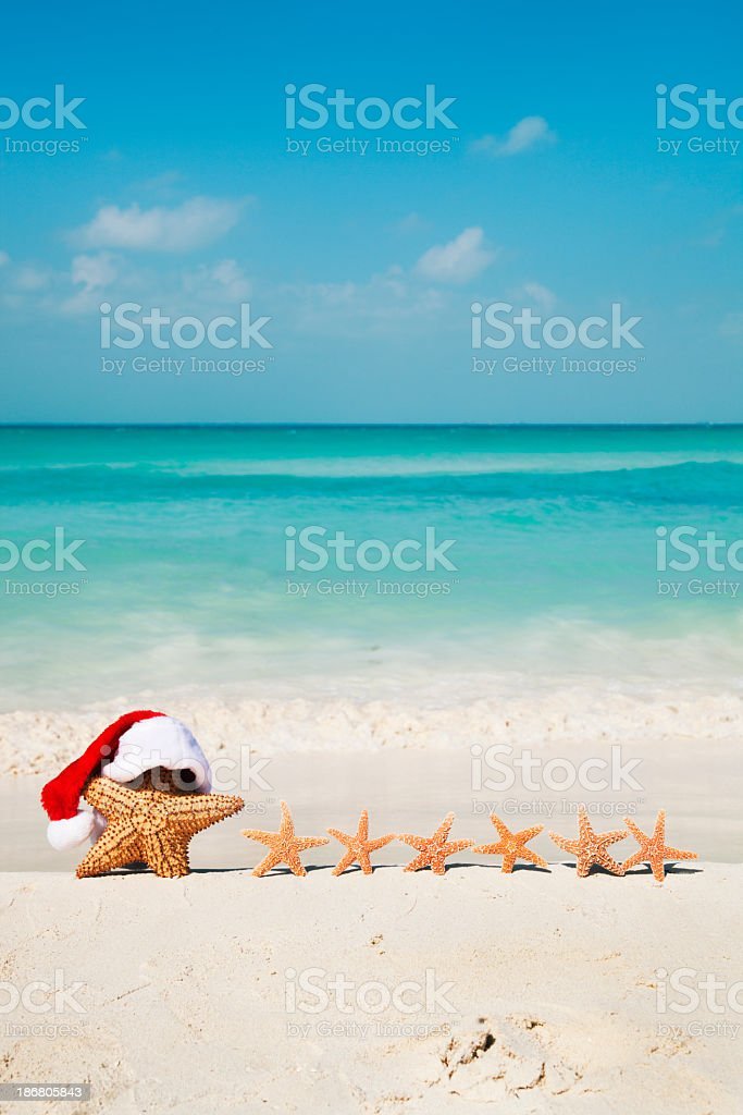 Christmas Beach Santa Claus, Starfish Family Tropical Holiday Vacation royalty-free stock photo
