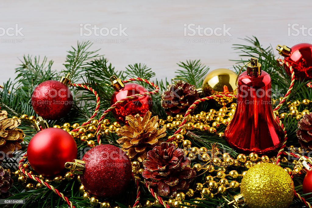 Christmas beads with pinecone, golden and red ornaments stock photo