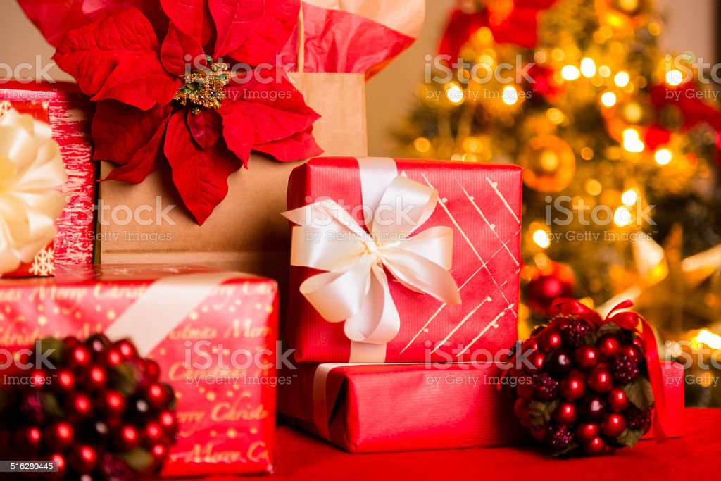 Group of beautifully wrapped, hand-decorated Christmas presents in...