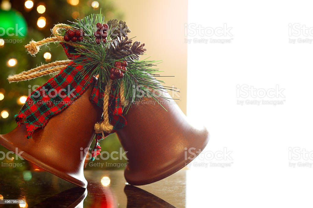 Christmas Bell Ornament With Blurred Christmas Tree In Background stock photo