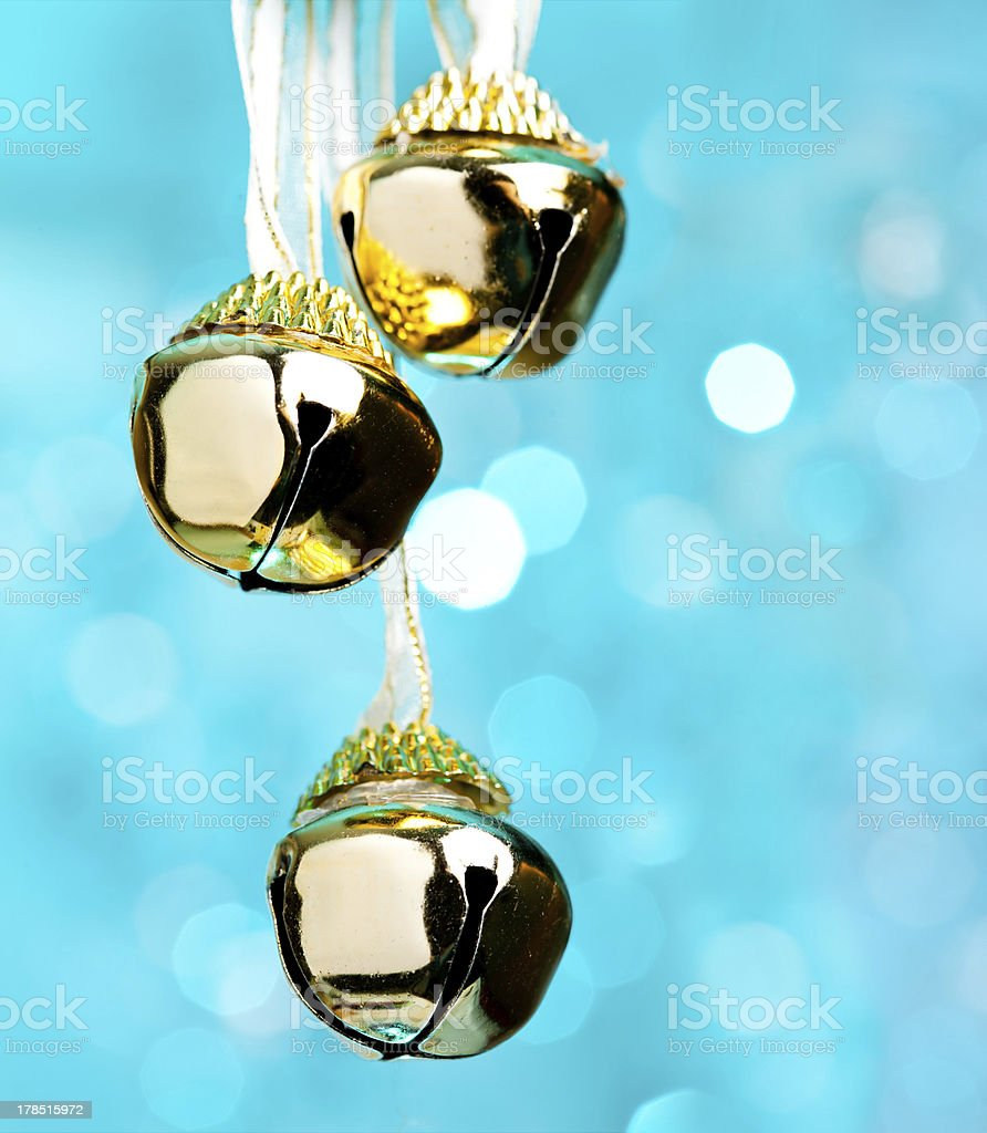Christmas bells with ribbon, defocused blue lights on background stock photo