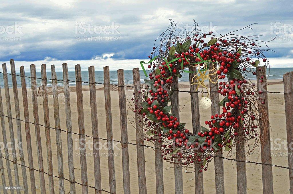 Christmas berry wreath with seashells royalty-free stock photo