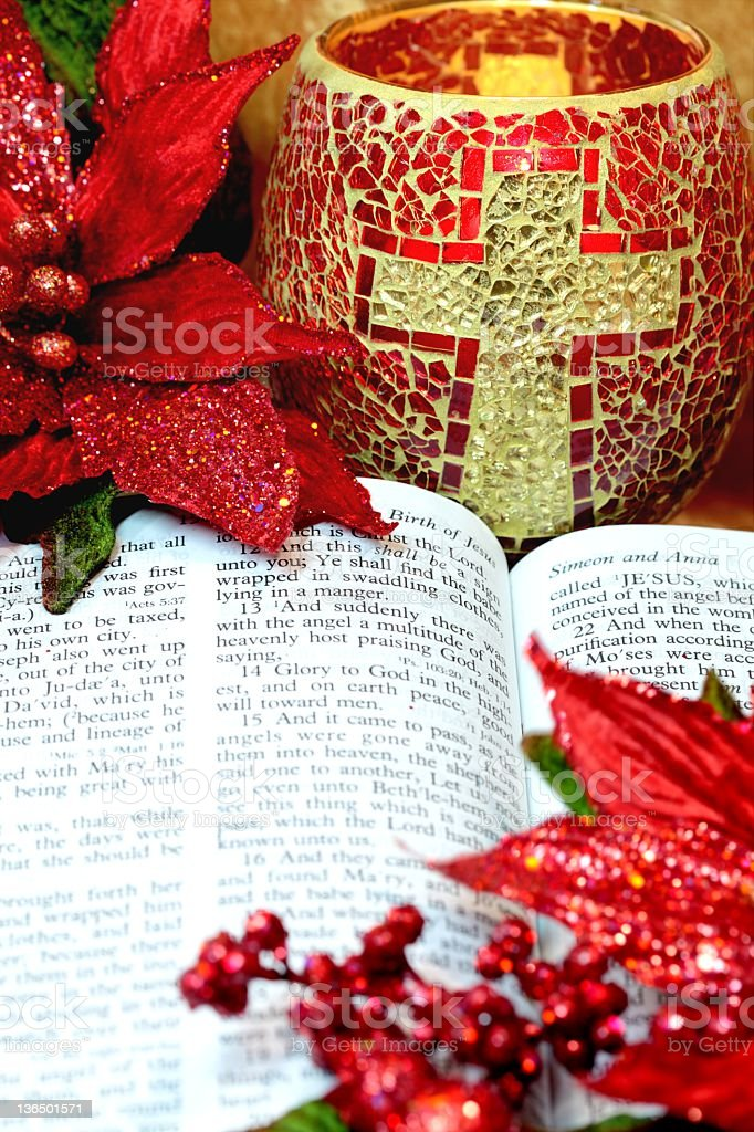 Christmas Bible and Poinsettias stock photo