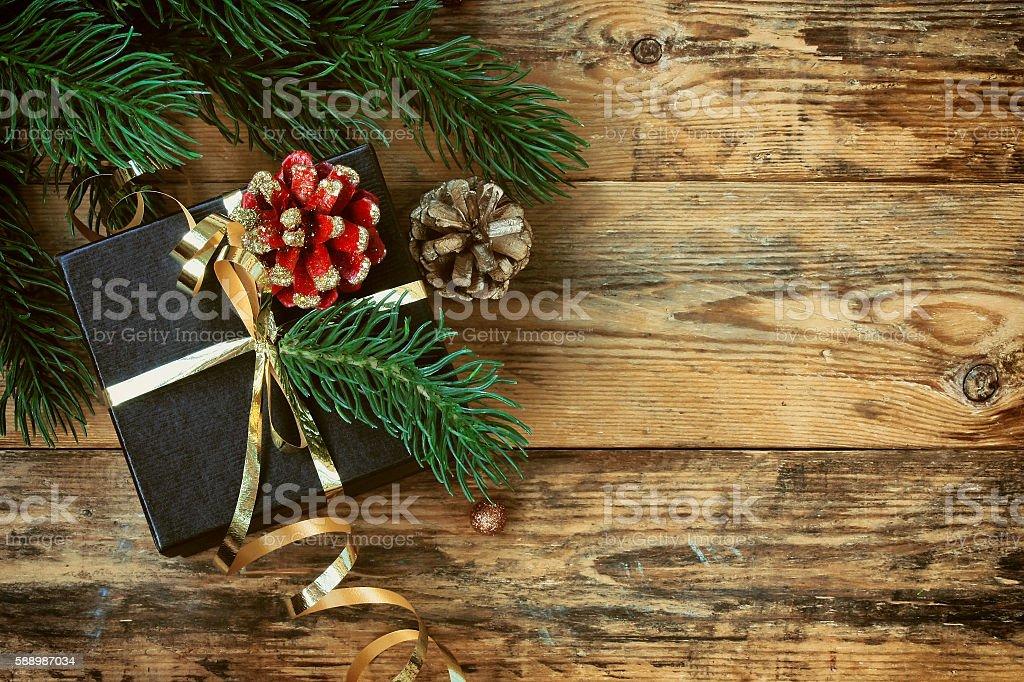 Christmas black gift box with gold ribbon stock photo