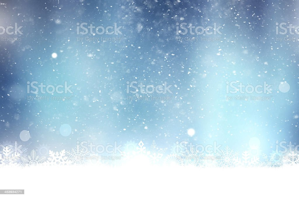 Christmas blue background with snow flakes stock photo