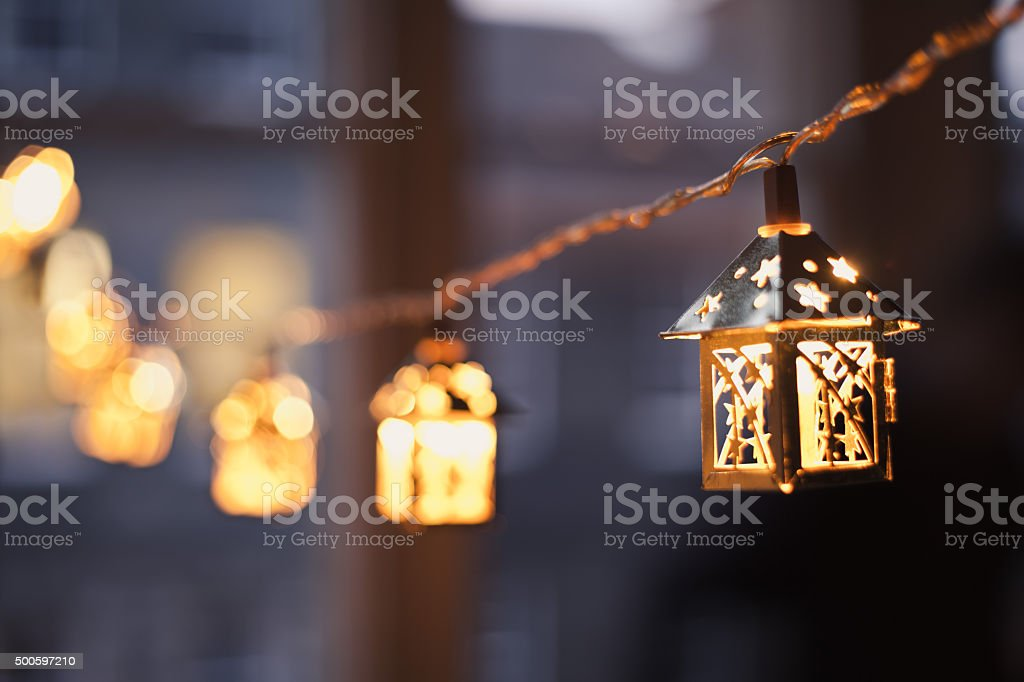 Christmas blue decoration. Colorful window in the city during winter. stock photo