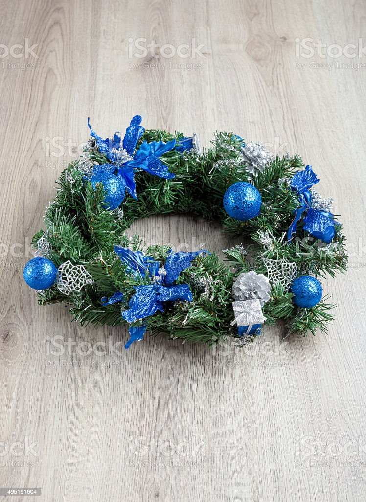 Christmas blue wreath on wood stock photo