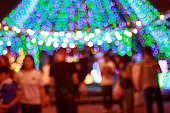 Christmas bokeh lights with blurred people