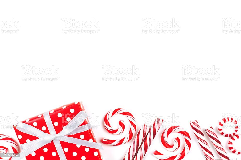 Christmas border of red and white gifts and candies stock photo
