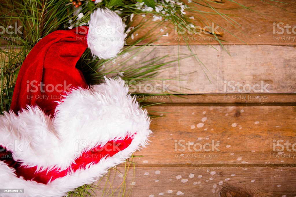 Christmas border with Santa hat, pine tree branch. stock photo