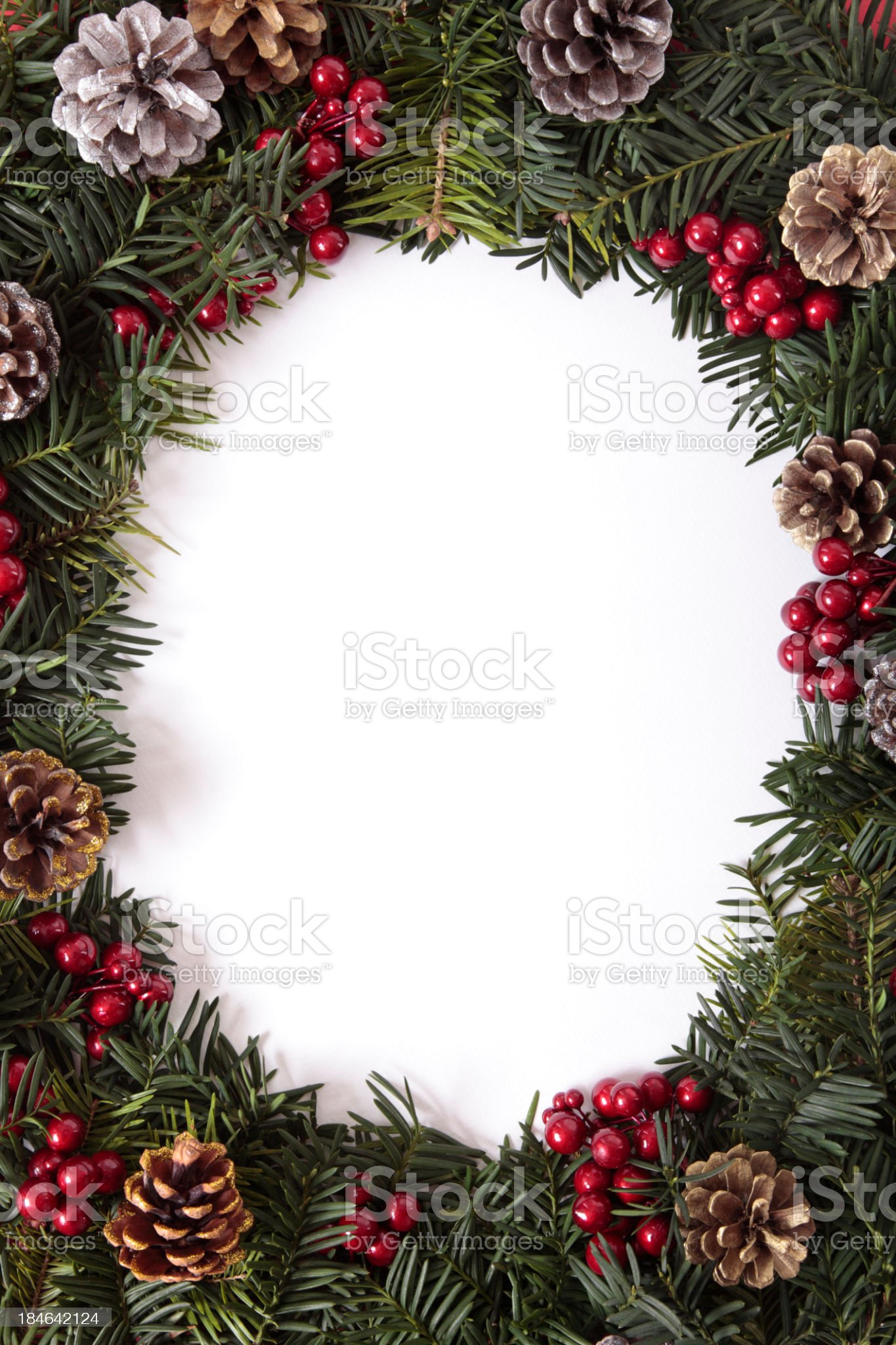 Christmas border wreath with pinecones and cranberries royalty-free stock photo