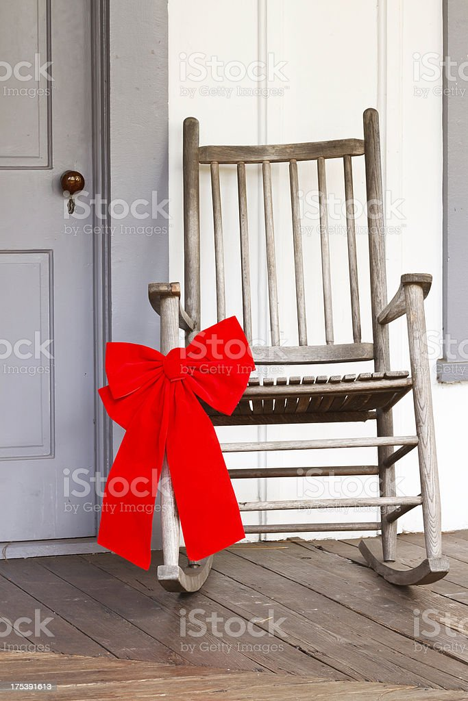 Christmas Bow On Rural Rocking Chair stock photo
