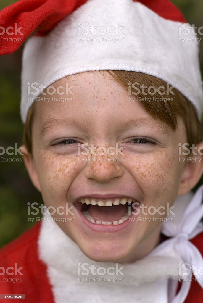 Christmas Boy, Laughing Santa Claus, Redhead & Freckles Child, Halloween Costume royalty-free stock photo