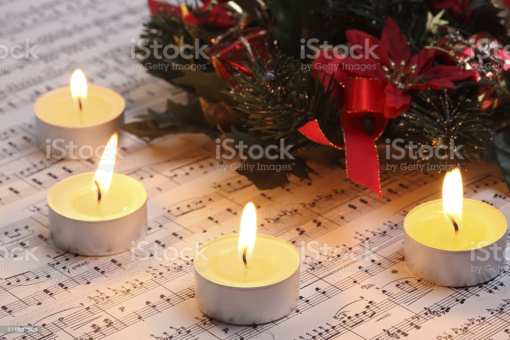Christmas Burning Tea Light with Music Notes and Wreath stock photo