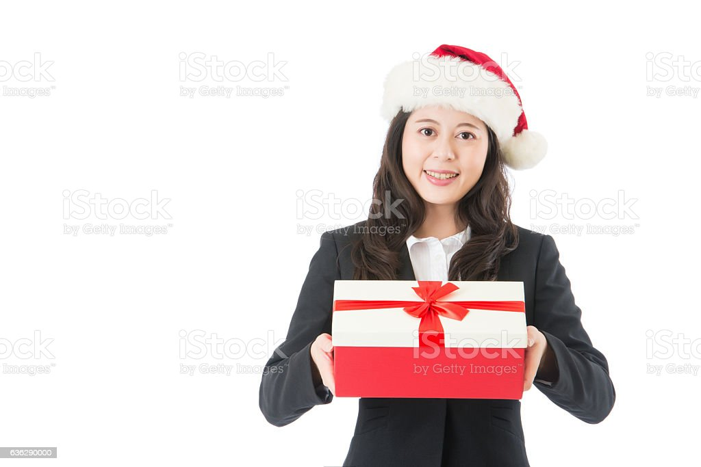 Christmas business woman smiling holding present stock photo