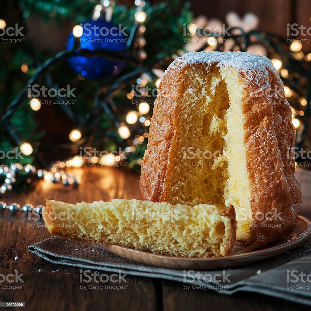 Christmas cake panetone on the wooden table stock photo