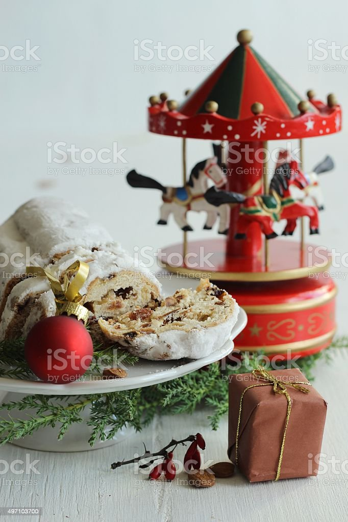 Christmas cake - Stollen, bauble and carousel music box stock photo