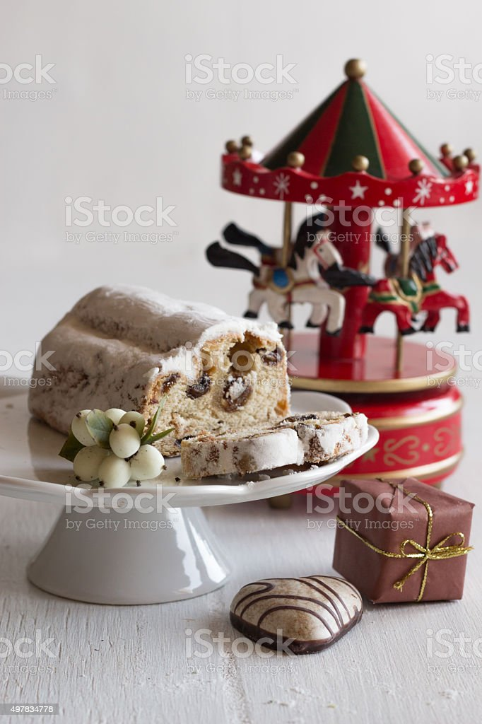 Christmas cake - Stollen,gift and carousel music box stock photo