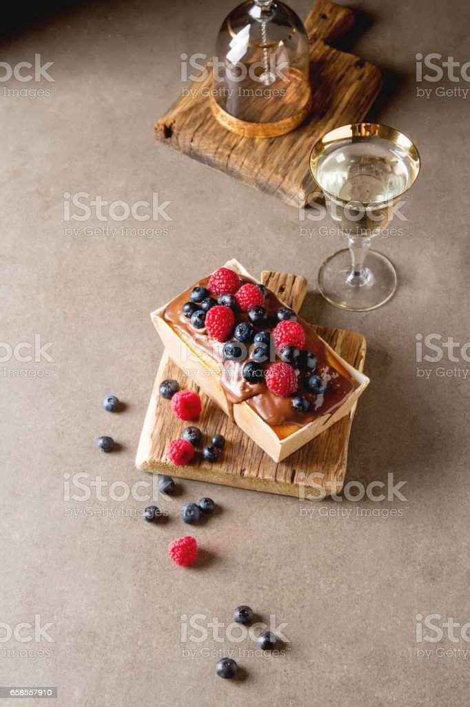 Christmas cake with chocolate frosting, blueberries and raspberr stock photo