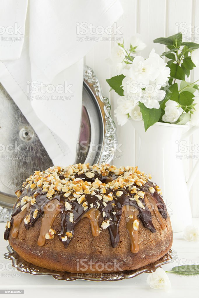 Christmas cake with condensed milk, chocolate, caramel and peanuts. royalty-free stock photo