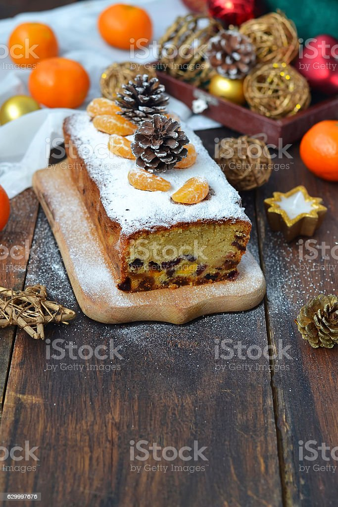 Christmas cake with dried fruits and tangerines stock photo