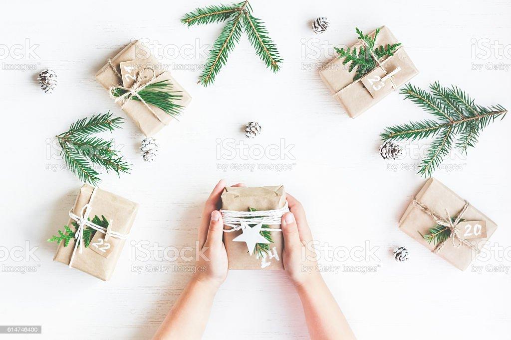 Christmas calendar. Christmas gift, fir branches, pine cones stock photo