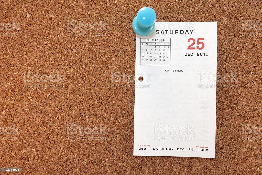 Christmas Calendar Page On Corkboard royalty-free stock photo