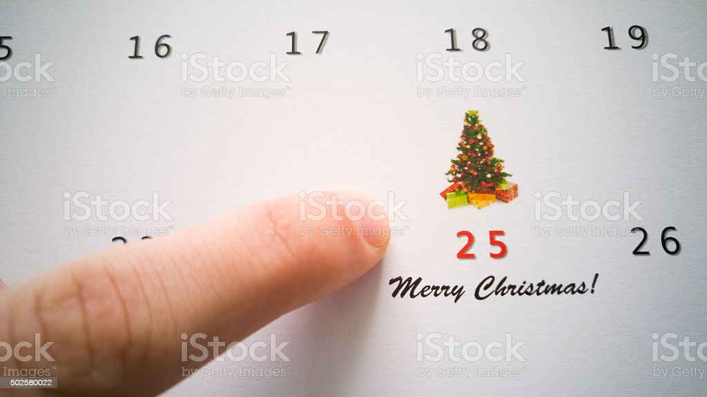 Christmas calendar with pointing on 25th December stock photo