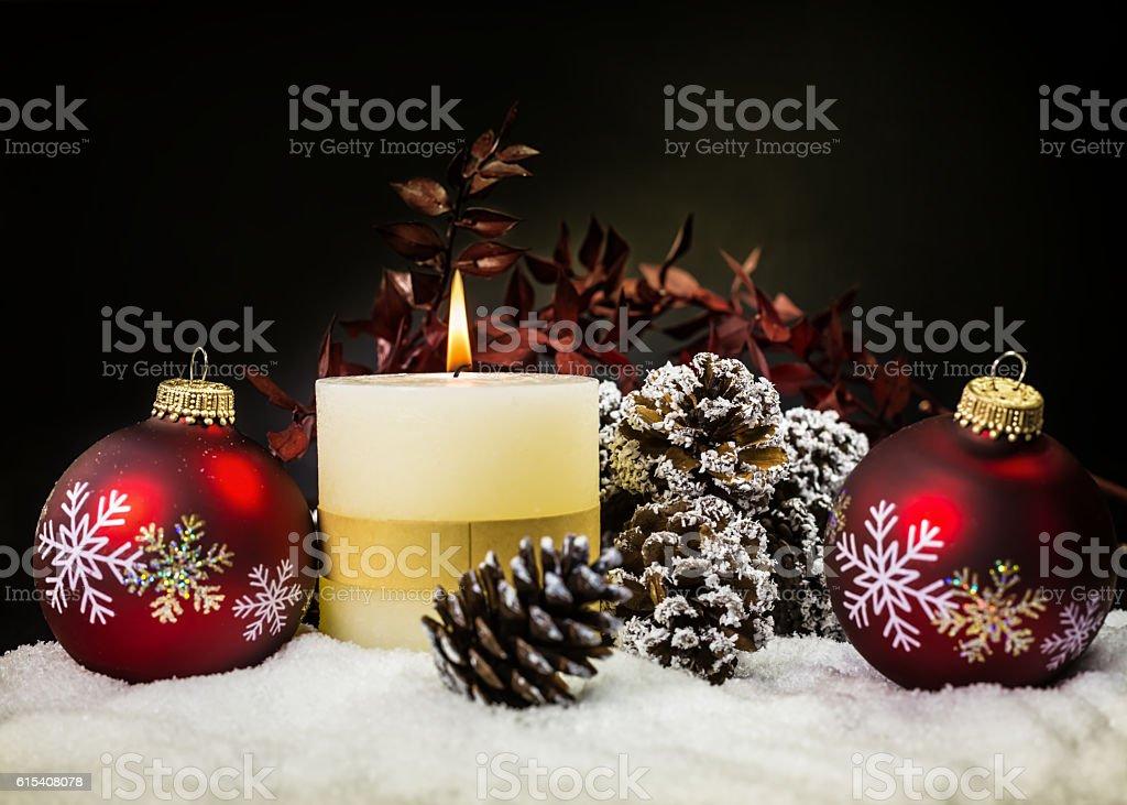 Christmas Candle and Christmas Balls with snow stock photo