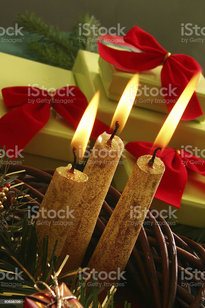 Christmas candle and gifts royalty-free stock photo