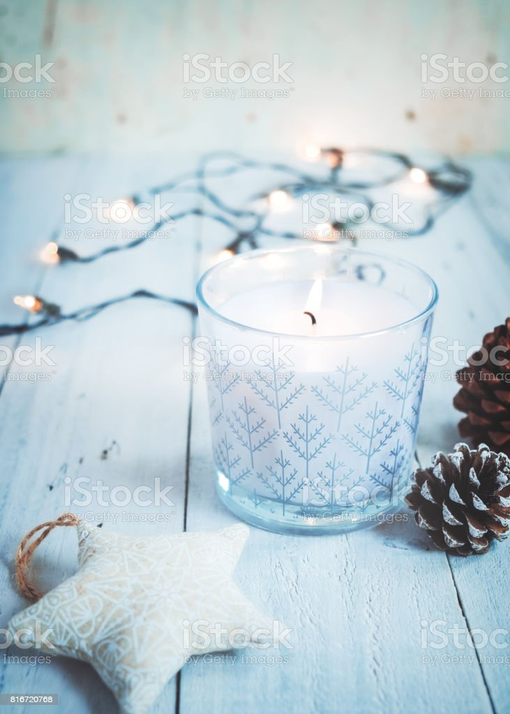 Christmas candle and rustic decoration stock photo
