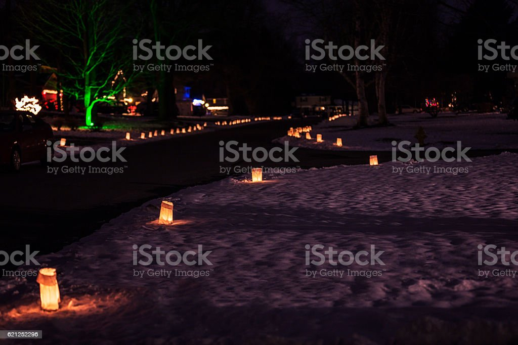 Christmas Candle Illuminated Paper Lanterns Lining Neighborhood Streets stock photo