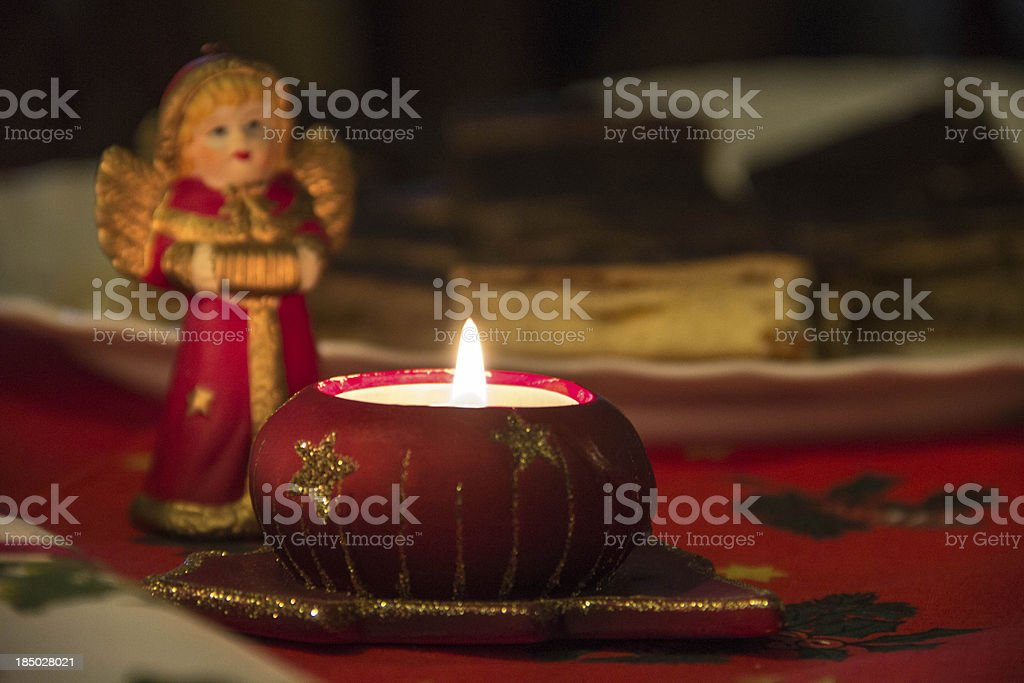 Christmas candle with angel stock photo