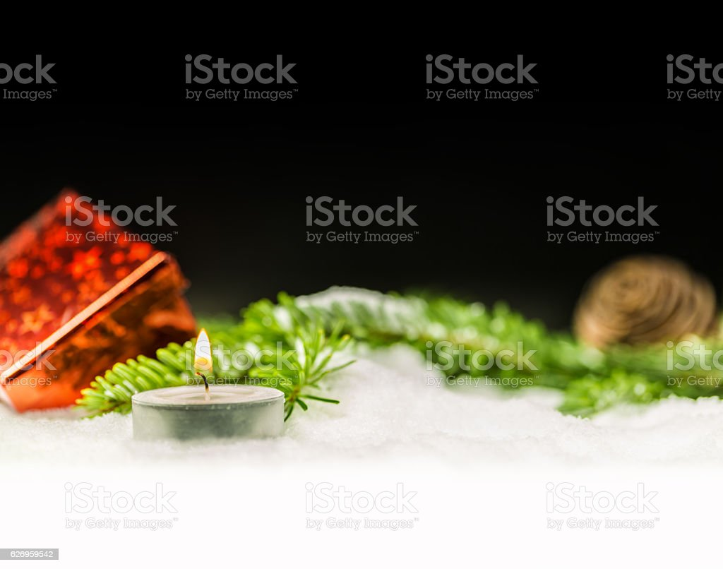 Christmas Candle with black background stock photo