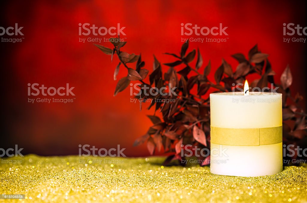 Christmas Candle with red backgound stock photo