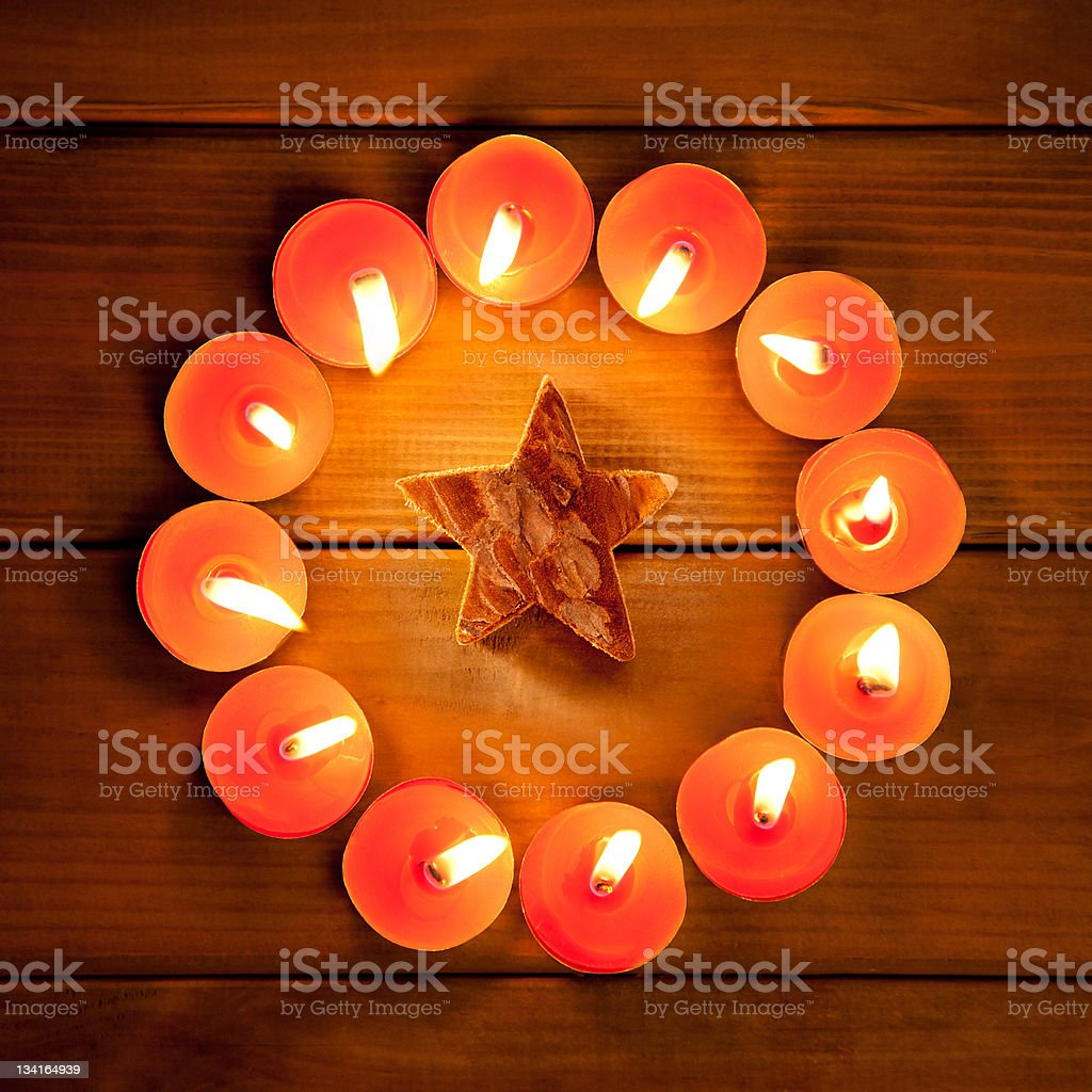 christmas candles circle over wood and symbol royalty-free stock photo