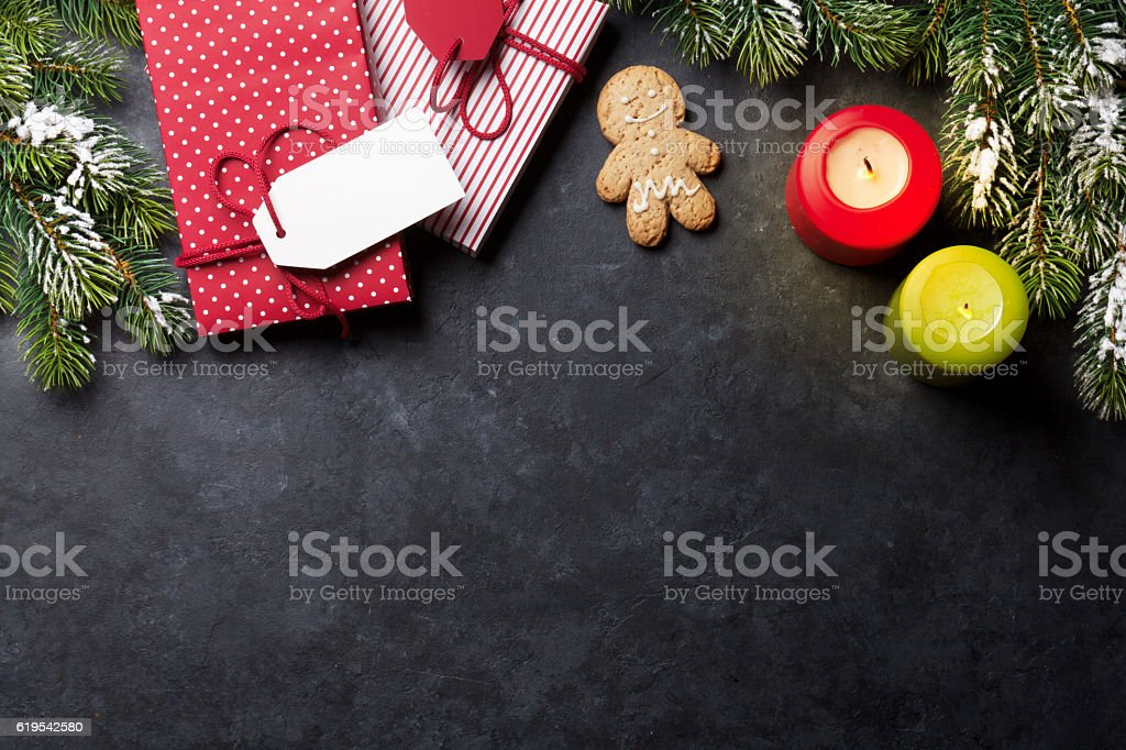 Christmas candles, gift boxes and snow fir tree stock photo