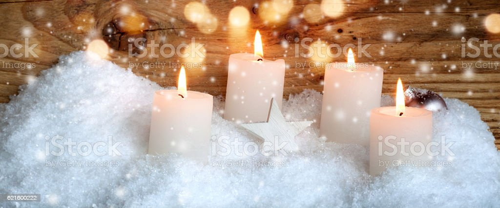 Christmas candles in the snow stock photo