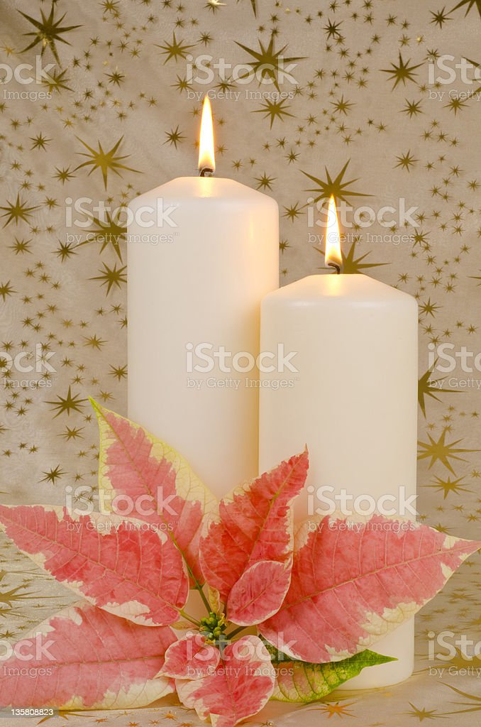 Christmas Candles with Pink Poinsettia stock photo